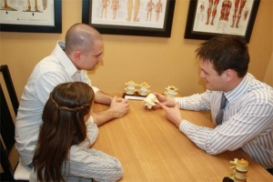 Chiropractic Care Consultation - Chiropractic Patient
